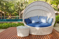 Nice Cozy White Round Chair With Canopy And Blue Cushions Royalty Free Stock Image - 29968696