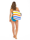 Woman In Swimsuit With Beach Bag Going Straight Royalty Free Stock Photos - 29971628