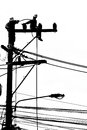 Silhouette Electrician Working On Electricity Post Royalty Free Stock Photography - 30002097