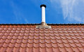 Red Tile Roof With A Tin Chimney Stock Photography - 30006972