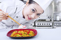 Asian Chef Prepare Noodle At Work Royalty Free Stock Photos - 30025438