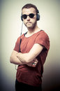Vintage Portrait Of Fashion Guy With Headphones And Sunglasses Stock Image - 30083711