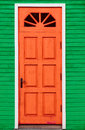 Red Vintage Wooden Door And Green Wall Royalty Free Stock Photography - 30092247