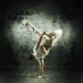 A Young And Sporty Man Doing A Modern Dance Pose Stock Images - 30109744