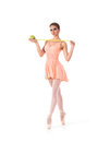 A Young And Fit Female Ballet Dancer In An Orange Dress Royalty Free Stock Image - 30114816