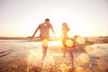 Couple Running On The Beach Royalty Free Stock Photo - 30133205