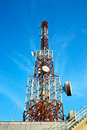 Red And White Antenna (cellular Tower) Under Blue Sky. Royalty Free Stock Photos - 30189408