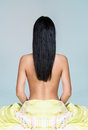 Woman With Long Black Hair Sitting On The Bed Royalty Free Stock Images - 30193189