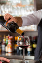 Red Wine Pouring In Glass At Bar Stock Photography - 30194052