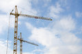 Elevating Crane Against The Cloudy Sky Royalty Free Stock Image - 30201836