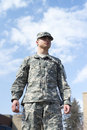 Soldier Stand Over Blue Sky Royalty Free Stock Photo - 30221275