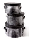 Set Of Houndstooth Check And Black Leather Bandboxes Royalty Free Stock Photo - 30229335