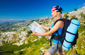 Cute Girl In Mountains Looking To Map Royalty Free Stock Photography - 30230937