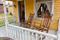 Old Rocking Chairs On Porch Royalty Free Stock Images - 30231189