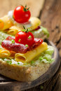 Closeup Of Sandwich With Salami, Tomato, Chive And Lettuce Stock Photos - 30251343