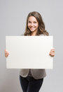 Young Businesswoman With Large Blank Banner. Stock Images - 30295004