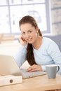 Young Woman Working On Laptop In Bright Office Royalty Free Stock Images - 30317229