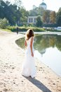 Young Girl Bride In A White Dress On The Sunny Coast Of The River Stock Images - 30368454