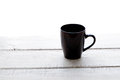 Empty Coffee Cup On A Wooden Table Over White Backgroun Stock Photos - 30382503