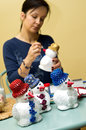 Woman Making Toy Snowman Royalty Free Stock Image - 30386556
