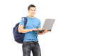 A Male Student With School Bag Working On A Laptop And Looking A Royalty Free Stock Photos - 30408098