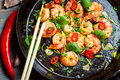 Shrimps Sauteed With Chilli Pepper On Old Black Pan Royalty Free Stock Photo - 30443015