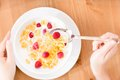 Top View Of Woman Eating Muesli With Strawberry And Milk Stock Photo - 30457900