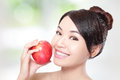 Young Woman Eating Red Apple With Health Teeth Stock Photography - 30460702