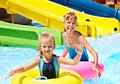 Child On Water Slide At Aquapark. Stock Photos - 30465313
