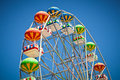Close-up Of Colorful Ferris Wheel On Vivid Blue Sky Stock Images - 30469474