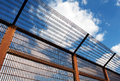 Security Fence Against Blue Sky Stock Images - 30483264