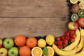 Fruits On A Wooden Board Royalty Free Stock Photo - 30499945