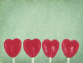 Row Of Red Lollipop Hearts On Vintage Background Royalty Free Stock Photo - 30507925