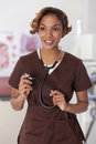 Woman In Scrubs Holds A Stethoscope. Stock Photos - 30522683