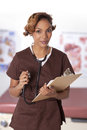 Female Nurse Holding A Clipboard And Stethoscope. Royalty Free Stock Photography - 30522687