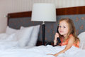 Little Girl Talking On Phone Royalty Free Stock Photography - 30524677
