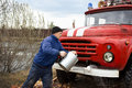 Driver Of The Water Washes The Old Fire Truck Stock Image - 30540311