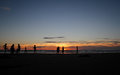 Silhouette Of Kids Playing On Beach Stock Images - 30542504