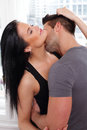 Young Woman Holding A Kissing Man Stock Photo - 30578830