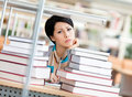 Sad Female Student Over The Books Royalty Free Stock Photos - 30587728