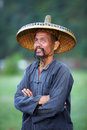 Chinese Man In Old Hat In Guangxi Region Stock Photos - 30615533