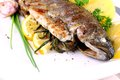 Grilled Whole Trout With Potato, Lemon And Garlic Stock Images - 30635824