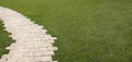 Flagstone Garden With Grass Lawn Stock Images - 30639514