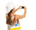 Beach Woman Taking Photo With Camera. Rear View Stock Photography - 30645492