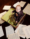 Caucasian Baby Boy Plays With Trumpet Royalty Free Stock Images - 30665919