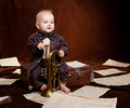 Caucasian Baby Boy Plays With Trumpet Stock Photos - 30665923