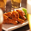 Buffalo Chicken Wings With Beer Stock Image - 30669111