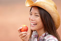 American Cowgirl Eating Peach Stock Photos - 30674543