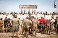Tough Mudder: Racers Waiting At The Everest Obstic Royalty Free Stock Images - 30715639