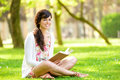 Woman Reading Book In Park Stock Images - 30732424